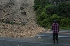 Some Napier residents may not be able to return to their homes for months because of this slip on Breakwater Rd. Photo / APN
