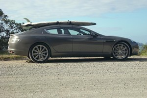 The Aston Martin Rapide looks like it was made for a longboard and fits plenty in the boot without even having the seats folded down. Photo / Eric Thompson