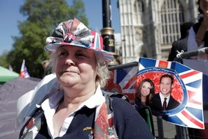 A royal enthusiast camps across the road from the Westminster Abbey in order to ensure the best viewing spot. Photo / AP