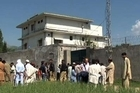Pakistan slammed the 'authorised' US raid on Osama bin Laden's compound, as more views of the compound itself emerged.