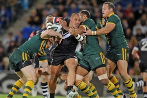 The Kangaroos defence piles in to stop a charging Jeremy Smith during last night's Anzac test. Photo / Getty Images