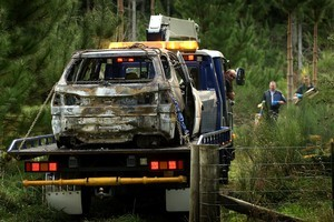 The burned-out remains of the vehicle are removed from a forestry block off Tumunui Road, south of Rotorua. Photo / Alan Gibson