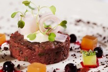 Ben Batterbury's venison tartare with blackcurrants, gin and chocolate. Photo / Supplied
