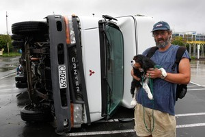 Robert Ahbel's dog, Louie, was still shaking several hours after he was blown 100m  across the carpark in the family's campervan. Photo / Brett Phibbs