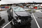 A wrecked car in the carpark outside Placemakers at the Albany Mega Centre. Photo / Brett Phibbs