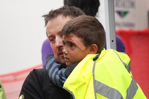 A young boy is helped from the Farmers building into an ambulance. Photo / Sarah Ivey