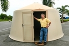 Charles Bree, head of Polybreeze, with a BreezePod emergency structure that can be built for $57,000. Photo / Martin Sykes