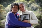 Grandmother Ada Morton and mother Sharlene Thompson with a photo of 16-year-old Rawiri Wilson. Photo / Greg Bowker