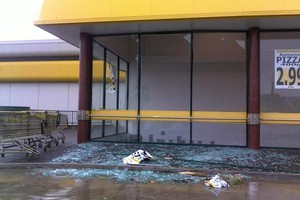 Shattered glass seen around Pak 'n Save in Albany. Photo / Milan Kumar