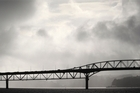 Storm clouds over the Auckland Harbour Bridge. Photo / Greg Bowker