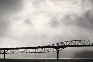 Storm clouds over the Auckland Harbour Bridge. Photo / Greg Bowker