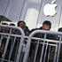 Chinese people react as they queue overnight between the barricade rails in front of the Xidan Apple Store for the chance to buy an iPad 2 on the first day of its sale in Beijing, China. Photo / AP