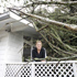 80 Roseberry Avenue. Alison Gilmour on the deck of her home at 80 Roseberry Avenue in Birkenhead. A tree has fallen over and is leaning on the house. Photo / Sarah Ivey
