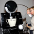 """Actress Kelly Rutherford and her son, Hermes Giersch, check out the """"Tassimo Brewbot"""" during a visit to the Tassimo Brewbot Café in New York. Photo / AP"""