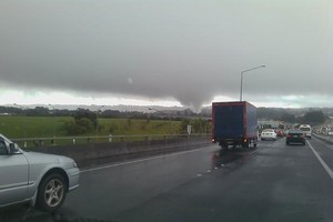 Aucklanders are being warned to watch the skies, with the possibility of more tornadoes tomorrow. Photo / Helen Travers