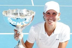 Greta Arn holds the winners trophy. Photo / NZPA