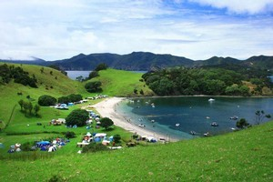 Camping sites at places like the Bay of Islands' Urupukapuka Island are entirely booked out this month. Photo / Diana Kurz
