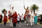 Accompanied by his father (far left), Vikram Kumar rides in a spectacular procession before his wedding. Photo / Steven McNicholl
