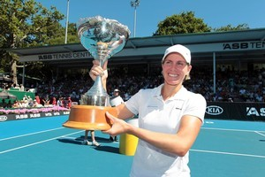 Greta Arn with the winner's trophy. Photo / Herald on Sunday