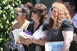 Raymond Saunders' widow, Jenny Saunders at his service in Te Awamutu. Photo / Herald on Sunday
