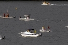 A teenage jet skier fell off and was run over by friends on a Rotorua lake. A flotilla of searchers look for his body. Photo / APN