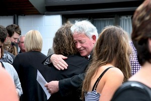 Bernie Monk embraces a supporter after a memorial service for his son Michael. Photo / Herald on Sunday.