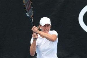 Greta Arn plays a backhand against Maria Sharapova. Photo / Getty Images