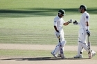 Pakistan's Misbah ul-Haq and Asad Shafiq celebrate their 100-run partnership. Photo / Getty Images