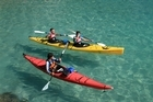 Learning the ropes with a company such as Cathedral Cove Kayaks can help you get the best out of your experience on the water. Below, getting instruction  from experts is  a sensible way to learn to surf. Photo / Supplied