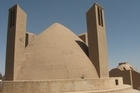 Two wind towers flank a water reservoir in a small desert village in central Iran. Photo / Jill Worrall