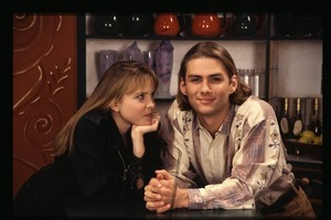 Rachel McKenna (Angela Bloomfield) with her onscreen brother Jonathan (Kieran Hutchison) back in the 90s. Photo / Supplied
