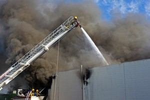 Dozens of firefighters have been called out to battle a blaze at a South Auckland factory. Photo / NZPA/David Rowland.
