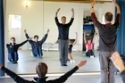 Timothy Gordon takes a class of adults through ballet lessons at his studio at his Grey Lynn studio. Photo / Steven McNicholl