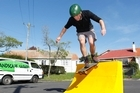 Justin Newcombe tries out his skateboard quarter pipe. Photo / Steven McNicholl