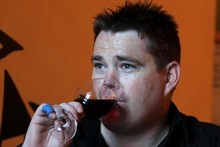 Mikey Leigh from the Wine Loft tests So2Go in a glass of wine. Photo / Janna Dixon