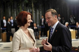 Australian Prime Minister Julia Gillard chats with New Zealand Prime Minister John Key. Photo / Supplied
