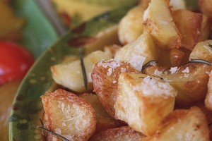 Using hot duck fat to roast potatoes adds a delicious flavour. Photo / Glenn Jeffrey