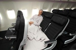 The Skycouch concept - demonstrated here by Air NZ ceo Rob Fyfe - has won a major design award. Photo / Janna Dixon