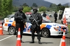The police in action in the Ureweras during the so-called 'terror raids'. Photo / NZ Herald