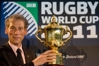 Mike Miller, CEO of the International Rugby Board holds the Webb Ellis Cup. Photo / File