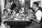 There wouldn't have been much chance to relax and enjoy Mother's Day for mum-of-10 Sally Sinden, shown here serving up breakfast to husband Paul and their eight oldest children.