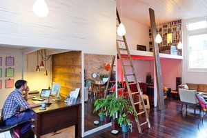 Jenny Miles and Nik Riviera commute to work via a ladder. Photo / Your Home & Garden