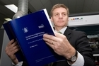 Finance Minister Bill English viewing a copy of the 2010 Budget  at Printlink in Petone.  19 May 2010 New Zealand Herald Photograph by Mark Mitchell