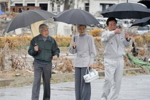 Japan's Emperor Akihiro and Empress Michiko are shown around by the mayor of Soma City (right). Photo / AFP