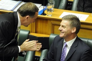 Prime Minister John Key applauds Finance Minister Bill English after reading the 2011 Budget. Photo / NZPA/Ross Setford.