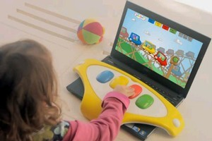 The Jumboard computer keyboard is plastic, large and has only 4 huge and brightly-coloured buttons. Photo / Supplied