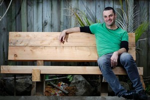 Justin Newcombe takes a well-deserved rest on his garden seat. Photo / Natalie Slade