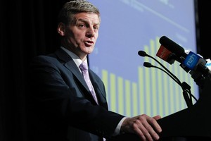 Finance Minister Bill English briefing journalists and analysts on the details of his 2011 Budget. Photo / Mark Mitchell