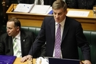 Finance Minister Bill English reading his 2011 Budget in Parliament. Photo / Mark Mitchell