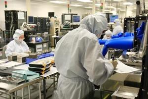 Rakon staff manufacturing electronic components at Rakon's Auckland factory. Photo / Martin Sykes